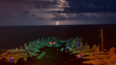 FILE PHOTO: US Navy aircraft carrier USS Nimitz as it transits the South China Sea July 4, 2020. © US Navy / John Philip Wagner, Jr.