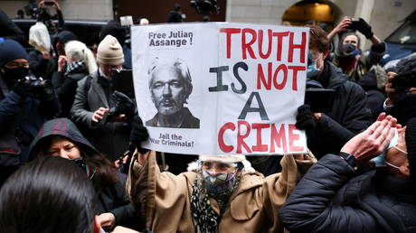 People celebrate after a judge ruled that WikiLeaks founder Julian Assange should not be extradited to the United States, outside the Old Bailey, the Central Criminal Court, in London, Britain, January 4, 2021.