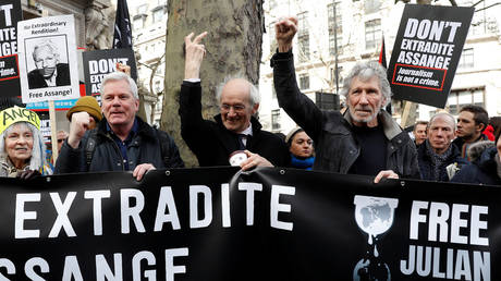 FILE PHOTO: Roger Waters (R) and other supporters of WikiLeaks attend a protest against the extradition of Julian Assange outside the Australian High Commission in London, Britain.