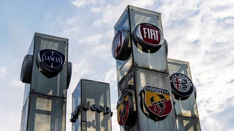 A car dealer in Turin shows the logos of brands of Fiat Chrysler Automobiles (FCA) company.