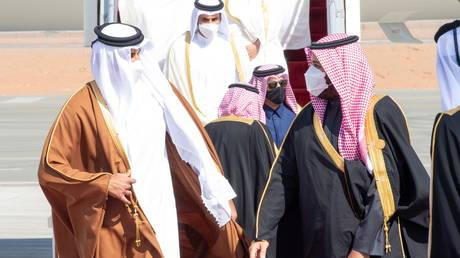 Saudi Arabia's Crown Prince Mohammed bin Salman welcomes Qatar's Emir Sheikh Tamim bin Hamad al-Thani upon his arrival to attend the Gulf Cooperation Council's (GCC) 41st Summit in Al-Ula, Saudi Arabia January 5, 2021.