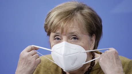 German Chancellor Angela Merkel wears a protective mask as she arrives for a news conference in Berlin, Germany, on January 5, 2021.