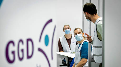 FILE PHOTO: Healthcare workers are seen at the Expo Houten event complex in Houten, Netherlands, on January 5, 2021.