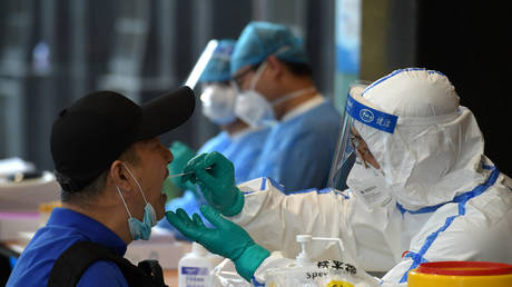 FILE PHOTO: Medical staff collect swabs for Covid testing in Nanjing, China on June 15, 2020. © China Daily via REUTERS
