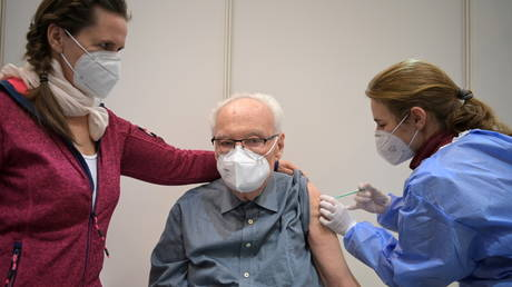 FILE PHOTO: An elderly person receives a vaccine in Potsdam, Germany, on Januray 5, 2021.