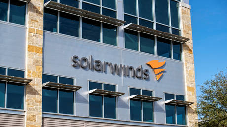 FILE PHOTO: The SolarWinds logo is seen outside its headquarters in Austin, Texas.