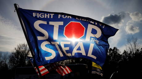 """FILE PHOTO: A """"Stop the Steal"""" flag flies outside a campaign rally with US President Donald Trump and GOP Senator Kelly Loeffler, in Dalton, Georgia, January 4, 2021."""