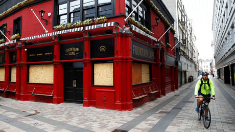 FILE PHOTO: A closed and boarded up pub is seen in Belfast following the outbreak of the coronavirus disease (COVID-19), Belfast, Northern Ireland, May 7, 2020.