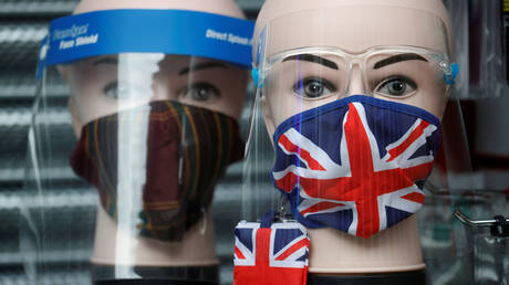 A Union Jack design face mask is seen for sale in the window of a shop amid the outbreak of the coronavirus disease