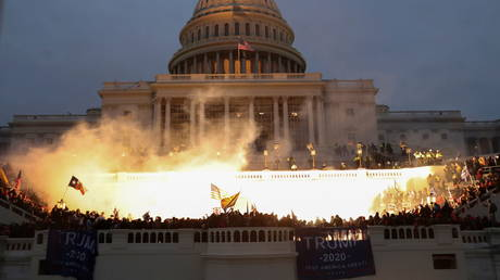 An explosion caused by a police munition is seen while supporters of U.S. President Donald Trump gather in front of the US Capitol Building in Washington, US, January 6, 2021