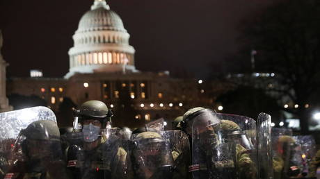 National Guard troops stand guard as supporters of President Donald Trump gather outside the US Capitol building during a protest against the certification of the 2020 election results, in Washington, DC, January 6, 2021.