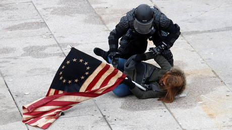 A Trump supporter is detained at the US Capitol building, January 6, 2021.