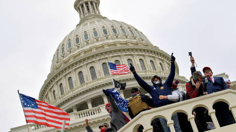 Supporters of President Donald Trump occupy the US Capitol Building in Washington, U.S., January 6, 2021.