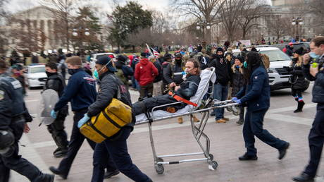 A D.C. Metropolitan Police officer is wheeled to an ambulance after supporters of U.S. President Donald Trump occupied the U.S. Capitol Building in Washington, U.S., January 6, 2021.