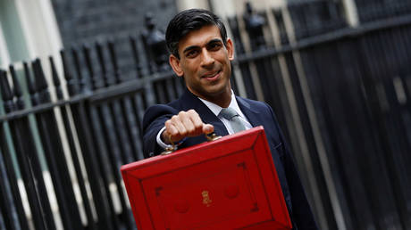 Britain's Chancellor of the Exchequer Rishi Sunak holds the budget box outside 11Downing Street