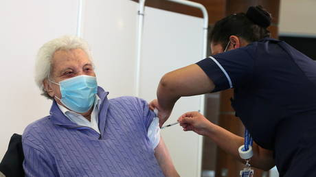 A person receives the Covid-19 vaccine in the UK