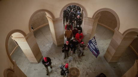 Supporters of US President Donald Trump enter the US Capitol, January 6, 2021.