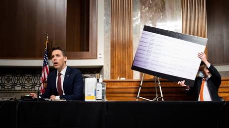 "US Senator Josh Hawley of Missouri questions Mark Zuckerberg during the Senate Judiciary Committee hearing on ""Breaking the News: Censorship, Suppression, and the 2020 Election"", in Washington, US, November 17, 2020."
