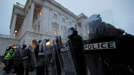 Police stand guard at the U.S. Capitol during a protest against the certification of the 2020 U.S. presidential election results by the US Congress, in Washington, US, January 6, 2021.
