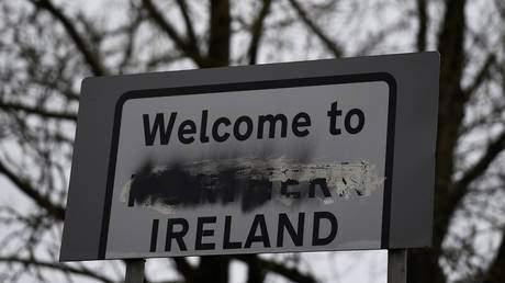FILE PHOTO. A defaced 'Welcome to Northern Ireland' sign.