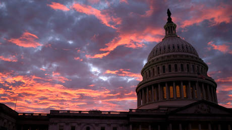 The sun sets on the US Capitol (FILE PHOTO) - and on the American Empire.