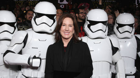 """Lucasfilm President Kathleen Kennedy poses with Stormtroopers at the Premiere of Walt Disney Pictures and Lucasfilm's """"Star Wars: The Force Awakens"""" at on December 14, 2015 in Hollywood, California. © Getty Images / Todd Williamson"""