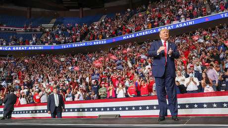FILE PHOTO: President Donald Trump speaks to a crowd onstage at his first re-election campaign rally at the BOK Center in Tulsa, Oklahoma, June 20, 2020.