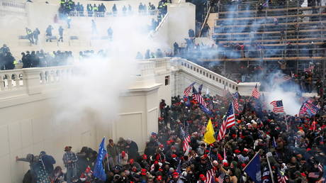 Police release tear gas into a crowd of pro-Trump protesters at the US Capitol Building in Washington, US, January 6, 2021