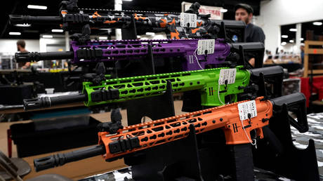 FILE PHOTO: AR-15 rifles with colored hand guards are displayed for sale at the Guntoberfest gun show in Oaks, Pennsylvania, US, October 6, 2017