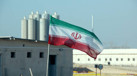 FILE PHOTO An Iranian flag in Iran's Bushehr nuclear power plant © AFP / ATTA KENARE