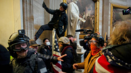 Protesters storm the Capitol Building in Washington, DC on January 6, 2021.