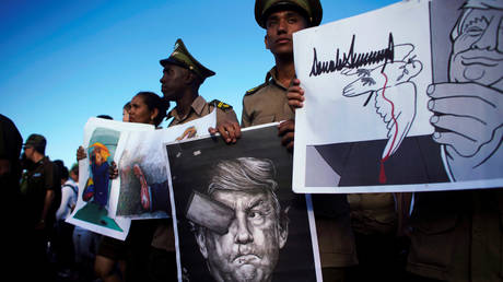 FILE PHOTO: Cuban soldiers carry images depicting US President Donald Trump during a May Day rally in Havana, Cuba.