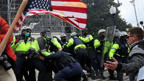 A mob of supporters of President Donald Trump clash with members of the US Capitol Police as they storm the US Capitol Building in Washington, DC, January 6, 2021.