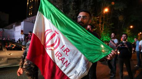 FILE PHOTO: Iranians celebrate the international agreement on the Iranian nuclear program in Tehran, July 2015. © Fatemeh Bahrami / Anadolu / Getty Images