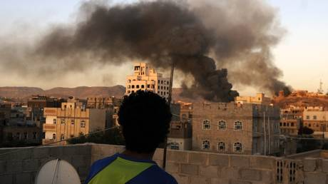 FILE PHOTO: Smoke rises over the Yemen government television building after the war crafts belonging to the Saudi-led coalition bombed there in Sanaa, Yemen on September 11, 2015