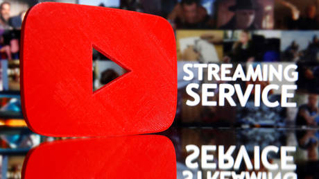 "FILE PHOTO: A 3D-printed Youtube logo is seen in front of displayed ""Streaming service"" words in this illustration taken March 24, 2020. © REUTERS/Dado Ruvic"
