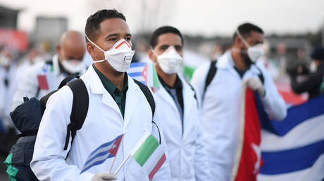 FILE PHOTO: An emergency contingent of Cuban doctors and nurses arrive at Italy's Malpensa airport after travelling from Cuba to help Italy battle the spread of coronavirus disease (COVID-19), near Milan, Italy, March 22, 2020