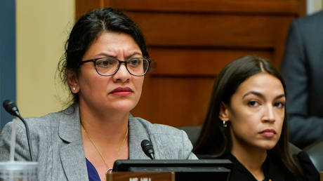 "Reps. Rashida Tlaib (D-MI) and Alexandria Ocasio-Cortez (D-NY) listen as Acting Homeland Security Secretary Kevin McAleenan testifies before the House Oversight and Reform Committee on ""Trump Administration's Child Separation Policy"" on Capitol Hill in Washington, U.S., July 18, 2019."
