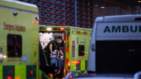 A NHS worker stands in an ambulance outside the Royal London Hospital, in London, Britain January 12, 2021