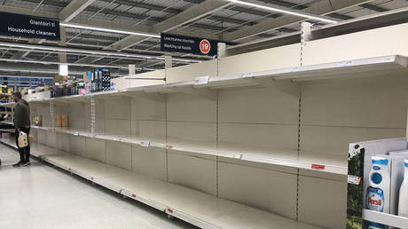 FILE PHOTO: A Sainsbury's supermarket in west Belfast with empty shelves