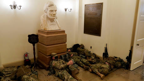 National Guard members sleep in the halls of the US Capitol, January 13, 2021.