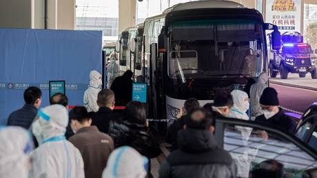 An expert team from the World Health Organization arrives in Wuhan, China, January 14, 2021. © AFP / Nicolas Asfouri