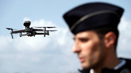 FILE PHOTO:  Police use a drone in Nice, France on March 20 to enforce Covid-19 rules.