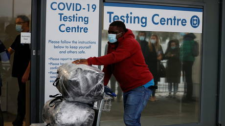 A passenger outside a testing centre at Manchester Airport, December 3, 2020
