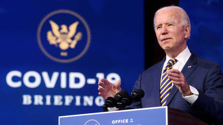 FILE PHOTO: President-elect Joe Biden delivers remarks at his transition headquarters in Wilmington, Delaware, December 29, 2020.