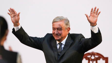 FILE PHOTO: Mexico's President Andres Manuel Lopez Obrador waves after giving an address at the National Palace in Mexico City, Mexico.