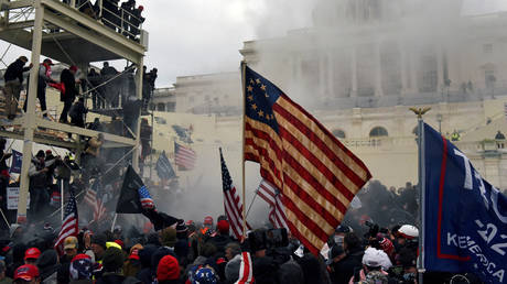 FILE PHOTO: FILE PHOTO: Supporters of U.S. President Donald Trump protest in front of the U.S. Capitol Building in Washington, U.S. January 6, 2021.