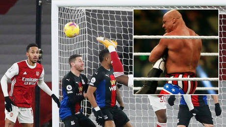 WWE star Kurt Angle's (right) 'You Suck' played at Arsenal's Premier League match with Crystal Palace © Alastair Grant / Reuters | © Faisal al Nasser / Reuters