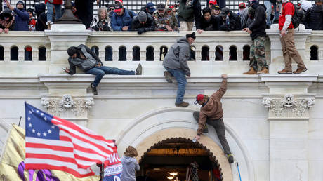 FILE PHOTO: A mob of supporters of U.S. President Donald Trump fight with members of law enforcement at a door they broke open as they storm the U.S. Capitol Building in Washington, U.S., January 6, 2021.