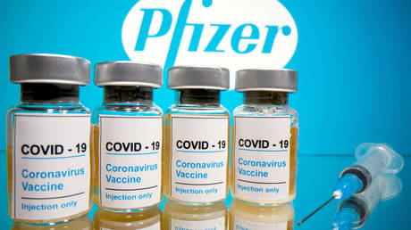 Vials of the Covid-19 vaccine and Pfizer logo